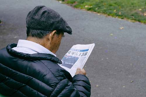 person man reading newspaper human