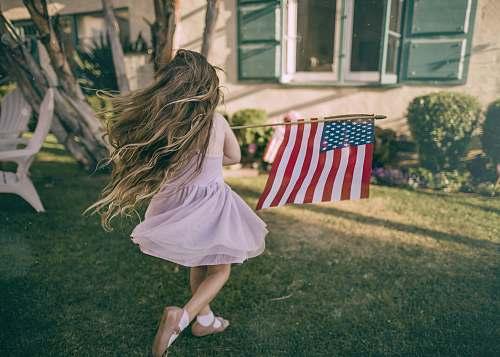 people girl holding flag of USA human