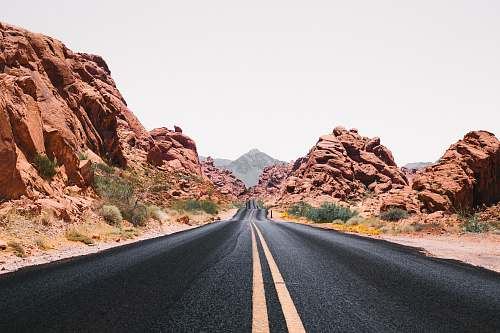 photo asphalt black road during day time valley of fire state park free for commercial use images