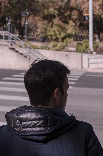 asphalt man standing in front of road tarmac