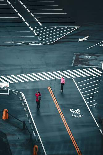 asphalt two people standing on road in aerial photo tarmac