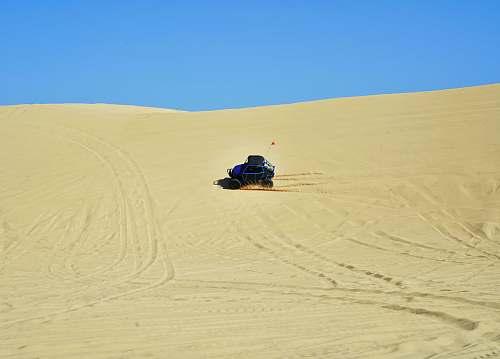 dune blue dune buggy on the desert desert
