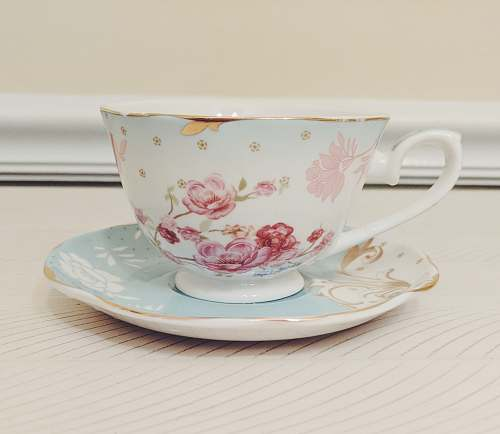 pottery white and pink floral ceramic teacup and saucer coffee cup