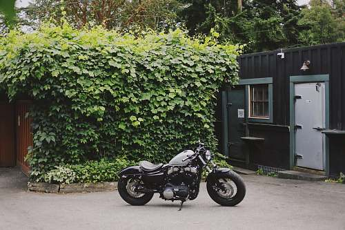 motorcycle gray and black bobber bike parked outdoor during daytime vehicle