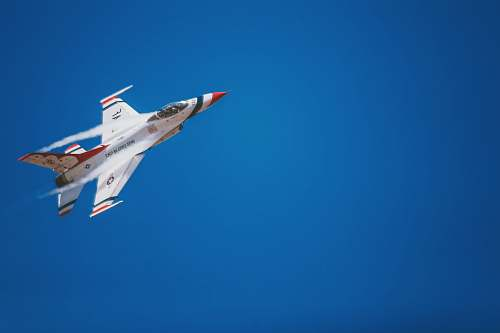 airplane white and red jet plane hovering on sky at daytime aircraft