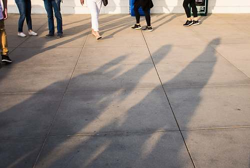 griffith observatory group of people standing on gray concrete tile flooring los angeles