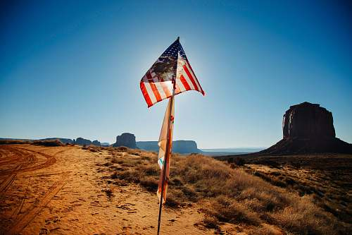 photo desert USA flag waving over brown sand outdoors free for commercial use images