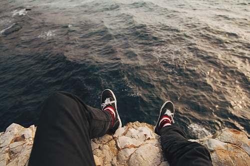shoe man sitting on cliff davenport