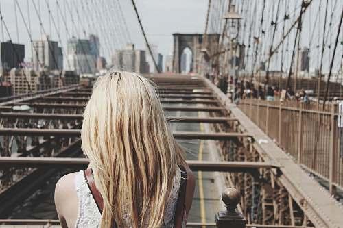 female woman on bridge blonde
