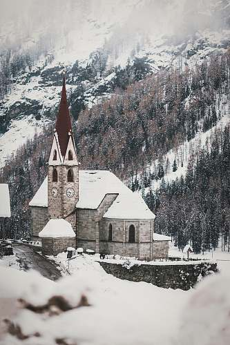 tower aerial photography of a cathedral covered with snow spire