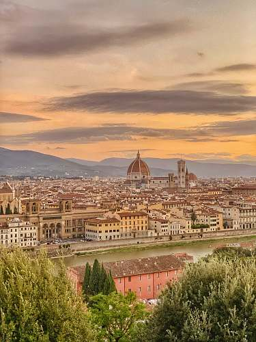 building aerial photography of Florence, Italy under white and orange sky during daytime dome