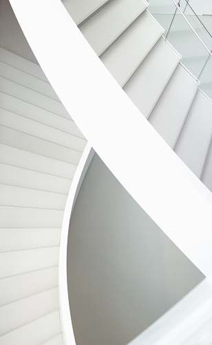 black-and-white aerial photography of spiral stairs paper