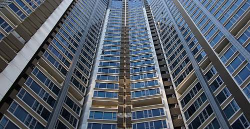 building architectural photography of blue and gray skyscraper skyscraper