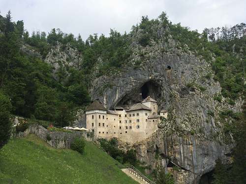 building beige castle by the rock mountain cave monastery