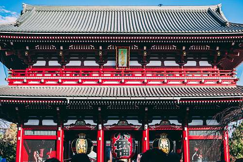 building black and red temple gate pagoda