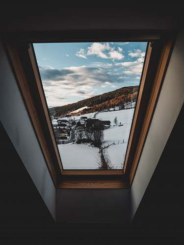 building black car on snow covered ground window