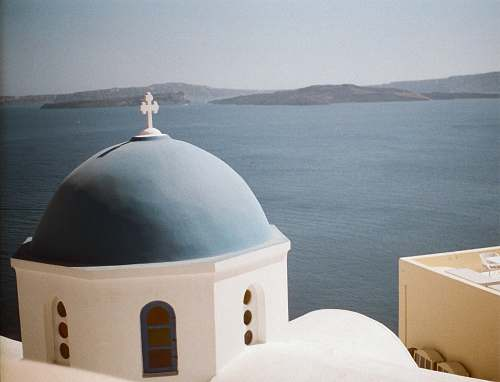 building blue and white church of Santorini, Greece dome