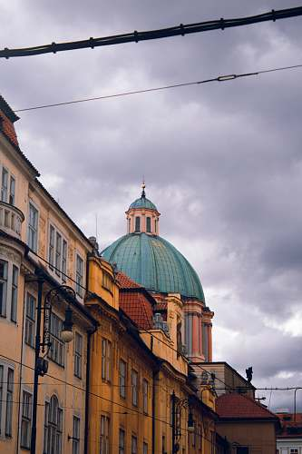 building blue dome building under white skies dome