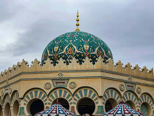 building brown and green mosque dome