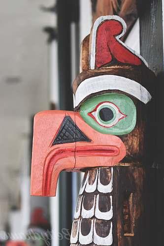 building brown and multicolored bird wooden decor symbol
