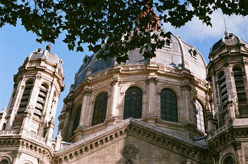 building brown and white dome building under blue sky dome