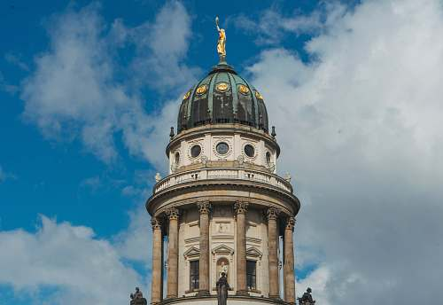 building brown and white tower under white and blue sky at daytime dome