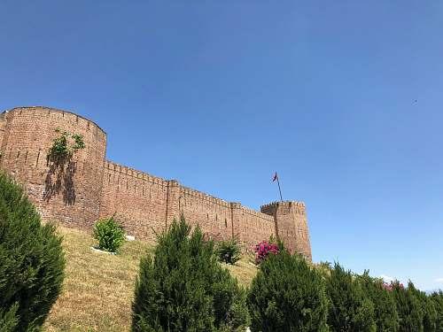 building brown castle under blue sky castle