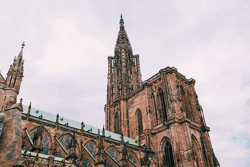 building brown cathedral during daytime spire