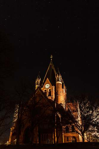 building brown cathedral during nighttime tower