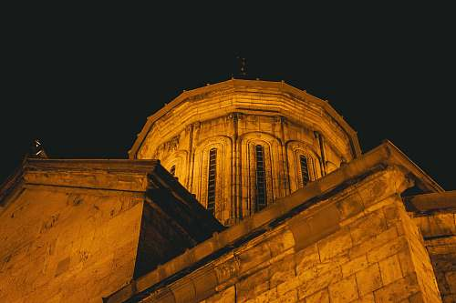 building brown concrete building at nighttime close-up photography dome