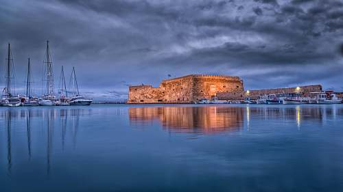 building brown concrete building on sea castle