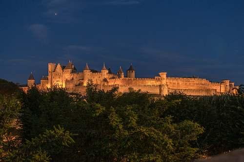building brown concrete castle at night castle