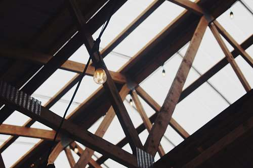 building brown wooden truss with clear roof window