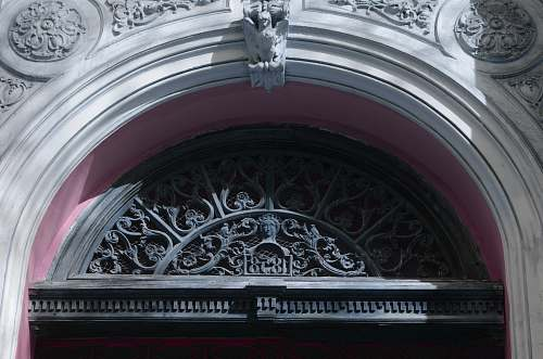 building building with ornate black doorway arch apse