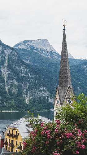 building cathedral with mountain at distance steeple