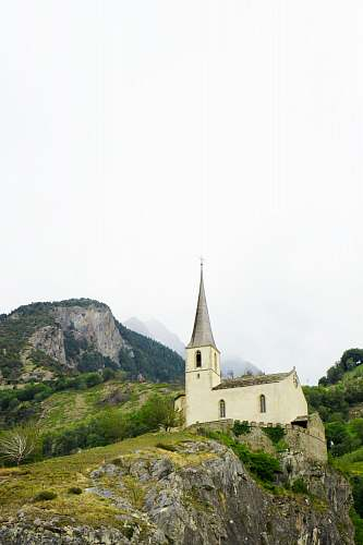 spire church on hill building