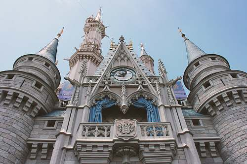 building close-up photography of castle during daytime spire