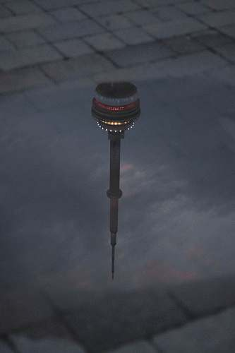 building CN tower reflection on water tower