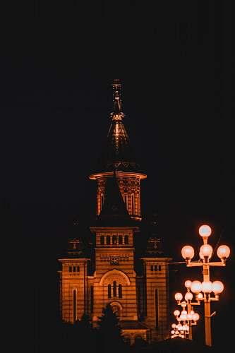 building concrete building at night spire