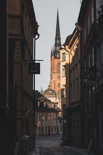 building empty building alley steeple