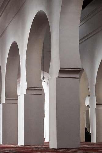 building empty white concrete building arch