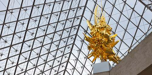 building gold-colored statue low-angle photography window