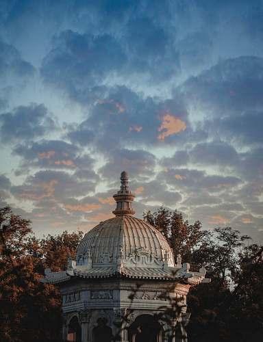 building Gothic gazebo under cloudy sky dome