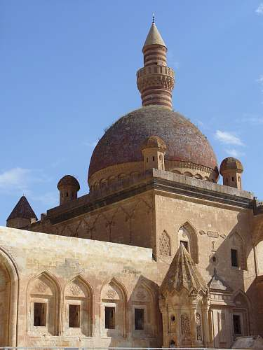 building gray and brown mosque during daytime dome
