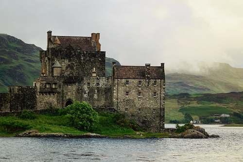 building gray castle on shore castle