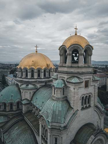 building gray stone church with domed roofs dome
