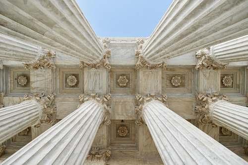 building gray stone columns worm's-eye view photo column