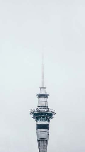 building gray tower during daytime spire