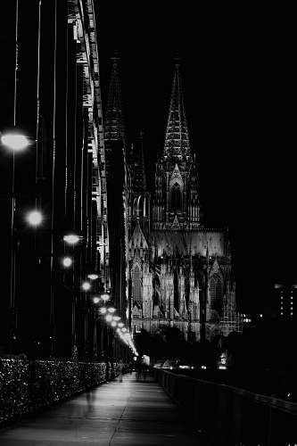 building grayscale photo of lighted cathedral black-and-white