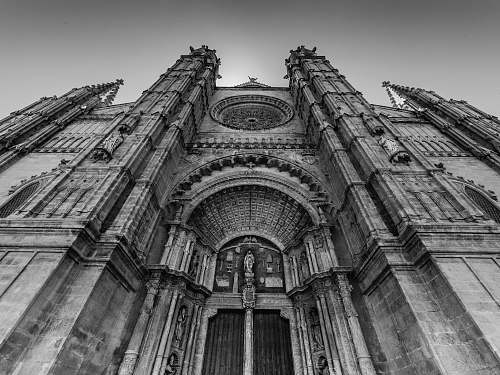 black-and-white grayscale photo of low angle photo of concrete building church
